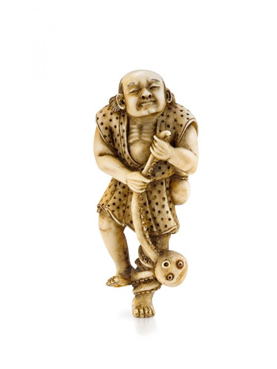 An ivory netsuke of a fisherman with an octopus, 19th century