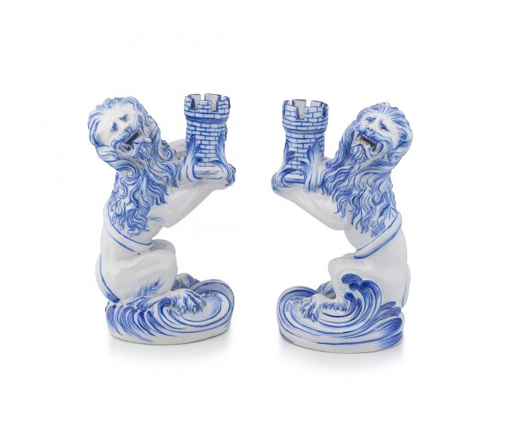 A pair of Emile Gallé Nancy St Clément blue and white faience candle holders, 19th century