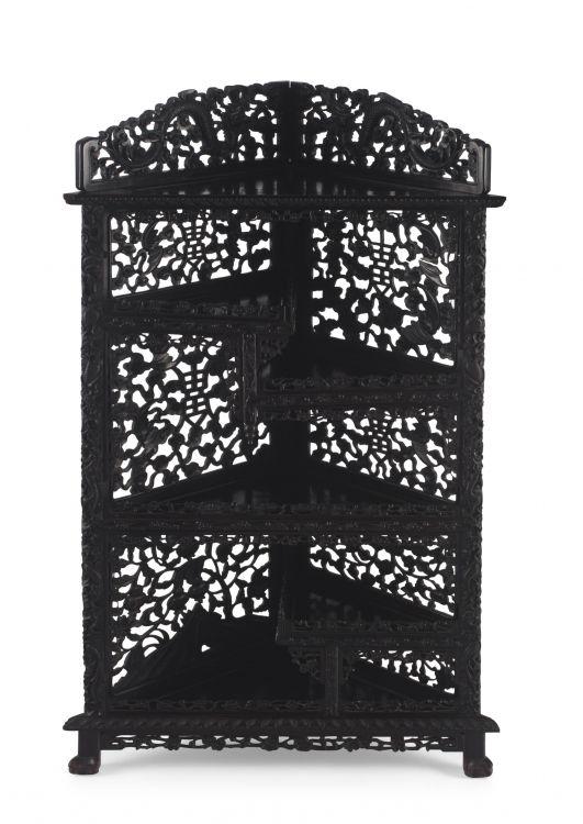 A Chinese ebonised hardwood 'bamboo' corner display stand, late 19th century