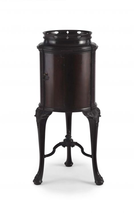 An Edwardian mahogany-veneered cross-banded drum-shaped cabinet