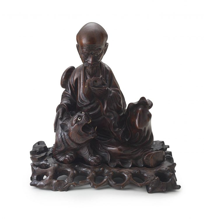 A Chinese carved hardwood figure of a scholar, 20th century