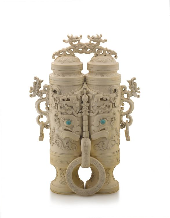 A Chinese ivory 'champion' vase and cover