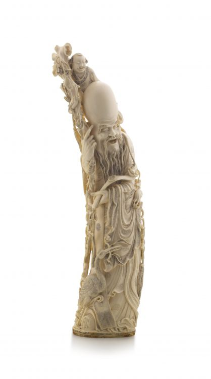A large Chinese ivory carving of Shou-lao, Qing Dynasty, late 19th/early 20th century