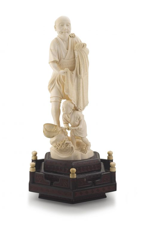 A tall Japanese ivory okimono of a fisherman, Meiji period, 1868-1912
