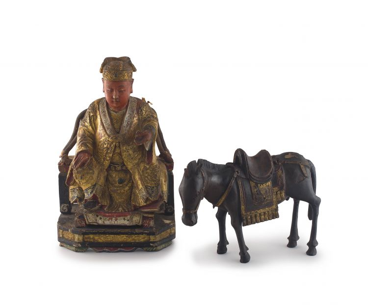A Chinese wood and gilt-lacquer figure of a courtier, Qing Dynasty, 18th century