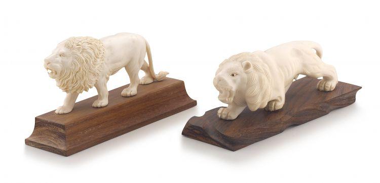 A Japanese ivory okimono of a lion, 20th century