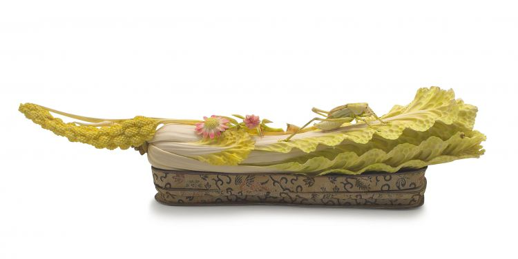 A Chinese stained ivory carving of a cabbage leaf, early 20th century