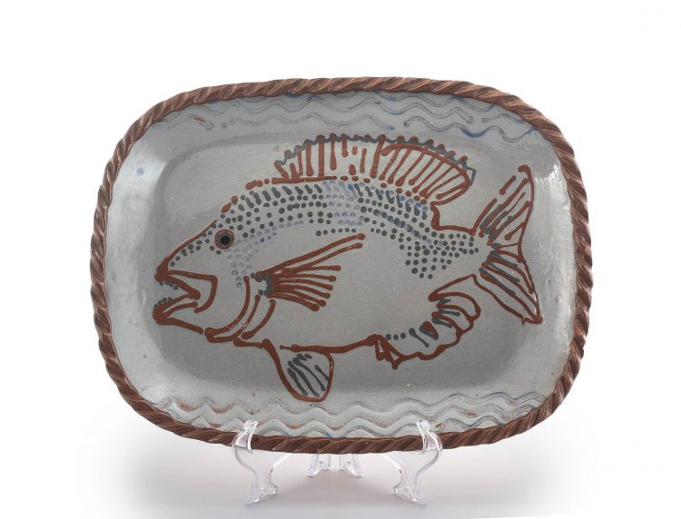 An earthenware-glazed dish, Juliet Armstrong, late 20th century