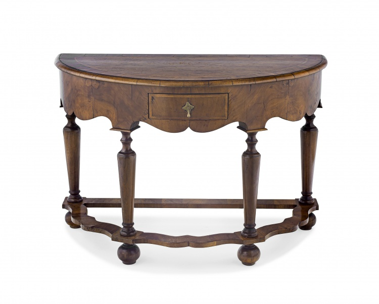 A walnut and fruitwood demi-lune table