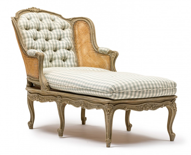 A Louis XVI style grey-painted, caned and upholstered day bed