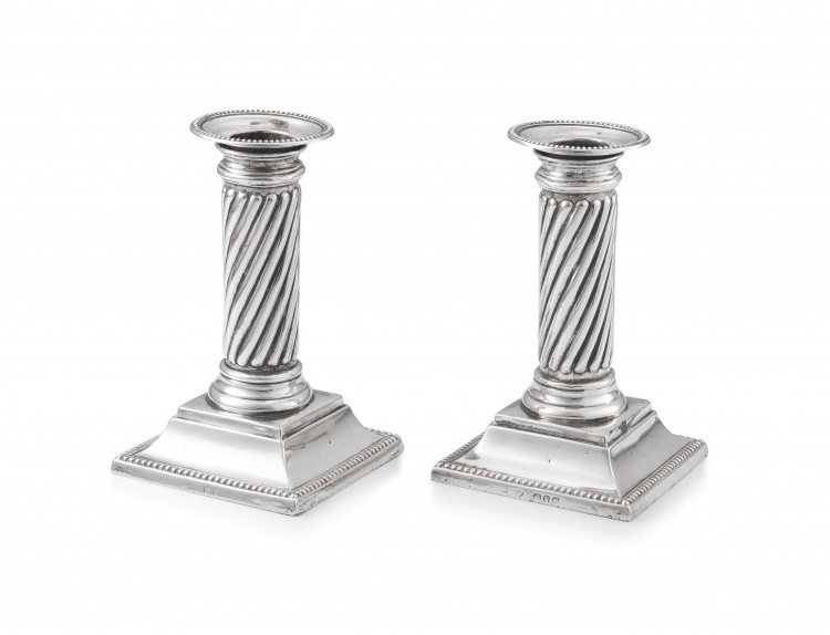 A pair of Victorian silver candlesticks, maker's marks worn, London, 1894
