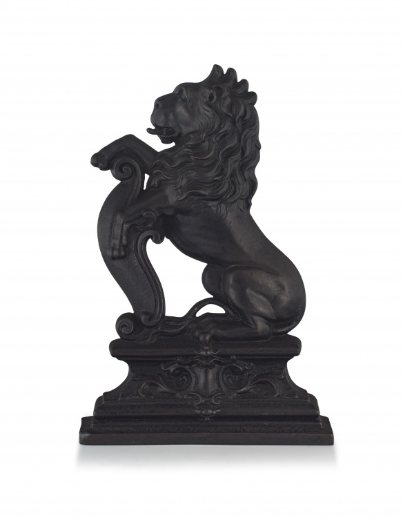 A black-painted cast-iron door stop, late 19th century