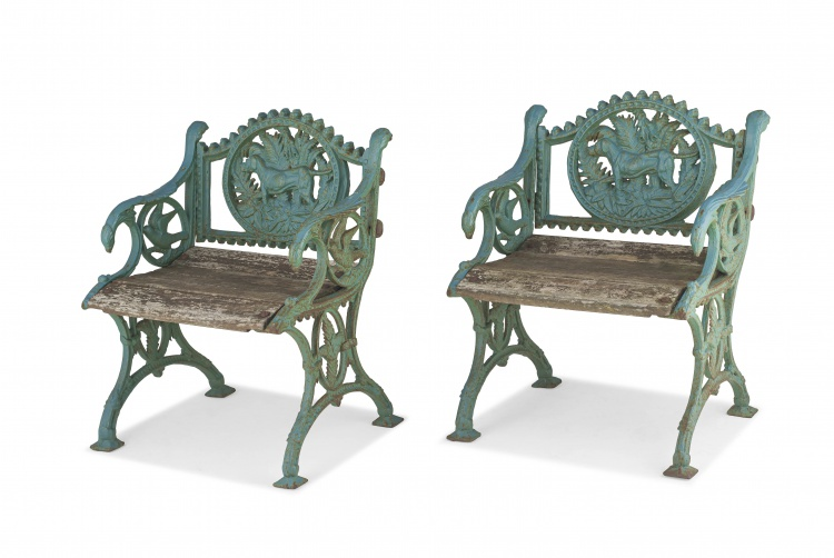 A pair of Victorian style 'Fern & Dog' wrought-iron armchairs