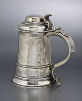 A George III silver lidded tankard, maker's mark TR, London, 1761