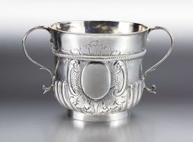 A Queen Anne silver two-handled porringer, makers mark indistinct, bearing marks for London, 1710