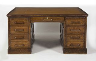 An American oak pedestal partners' desk, early 20th century
