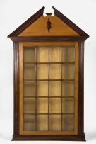 A Cape yellowwood and stinkwood wall cupboard, early 19th century