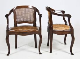 A pair of Cape stinkwood and caned tub chairs, early 19th century