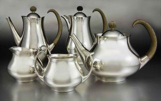 A Mappin and Webb silver five-piece 'Clements' pattern tea and café au lait service, Eric Clements, Sheffield, 1963