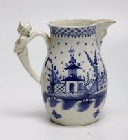 A Pearlware blue and white mask jug, late 18th century