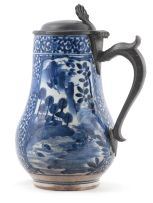 A Japanese Arita blue and white pewter-mounted tankard, 17th century
