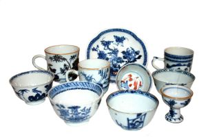 A miscellaneous group of four Chinese blue and white tea bowls, Qing Dynasty, 18th century