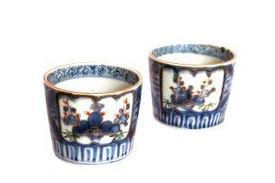A pair of Japanese blue and white beakers, 18th century