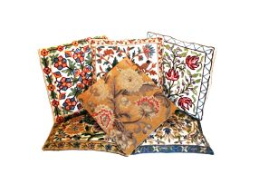 Five Indian crewelwork cushions, 20th century