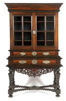 A Dutch East Indies Colonial coromandel, satinwood and ebony cabinet-on-stand, 18th century