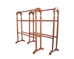 A pair of oak towel rails, 20th century