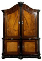 An important Cape stinkwood, beefwood, ebony and silver-mounted armoire, 18th century