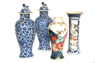 A pair of Chinese blue and white vases and covers, 19th century