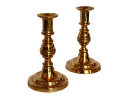 A pair of brass candlesticks, 19th century