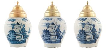 A garniture of three Dutch Delft De Vergulde Blompot tin-glazed blue and white snuff jars, 18th/19th century