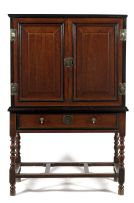A Dutch Colonial teak, rosewood and ebony cabinet-on-stand, 18th century