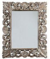 A carved wooden mirror