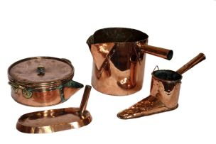 A copper and brass saucepan and cover