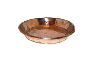 A copper circular dish