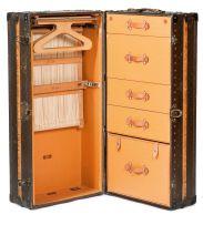 A Louis Vuitton monogram canvas metal and brass bound cabin trunk