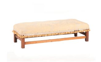 An oak upholstered low stool, 20th century