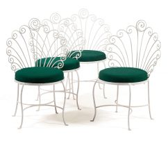 A set of four white-painted wrought iron patio chairs, modern