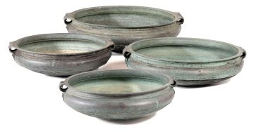 Four Indian patinated brass shallow vessels