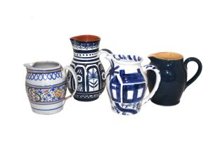 A miscellaneous group of four jugs