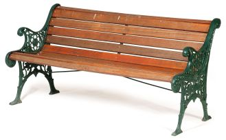 A green-painted wrought iron garden seat