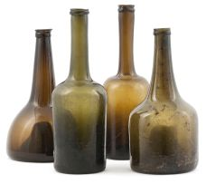 Four green glass bottles, 19th century