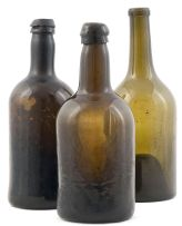 Three green glass bottles, 19th century