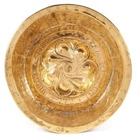 A Nuremberg brass alms bowl, 17th/18th century
