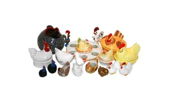 A miscellaneous collection of hen egg baskets and figures of chickens, modern