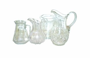 A miscellaneous group of clear glass jugs
