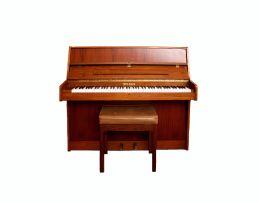 A Fritz Kuhla walnut upright piano